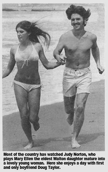 Nude couple posing on beach